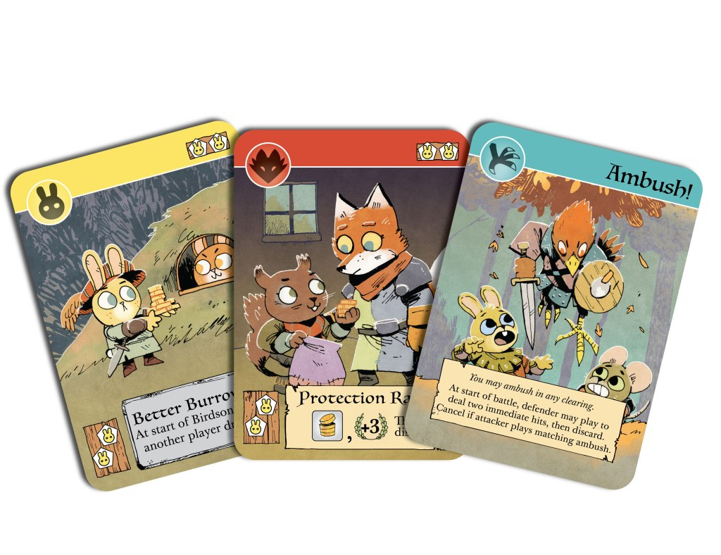 A fan of 3 cards featuring the cards Better Burrow Bank, Protection Racket, Ambush!.